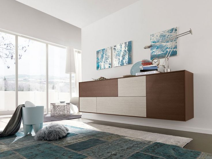 contrasting cupboard door colors can create a more interesting finish in a piece of living room