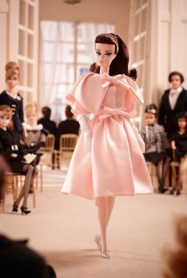 Blush Beauty™ Barbie® The finale of the 2015 Barbie® Fashion Model Collection arrives in a blush pink, cape-collared coat with lovely bows cinching the coat closed at the neckline and waistline. Remove the coat to reveal a beautifully tailored shift dress, the bodice glittering with micro-sequins.