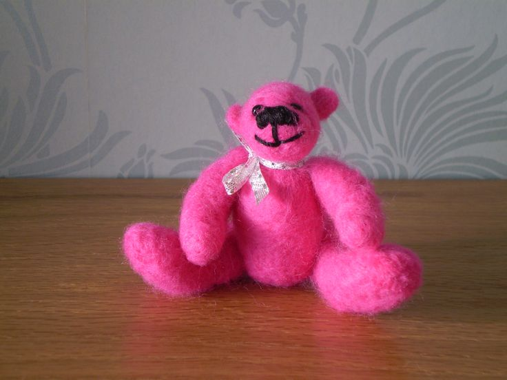 Katie is a bright pink needle felted bear made from merino wool.