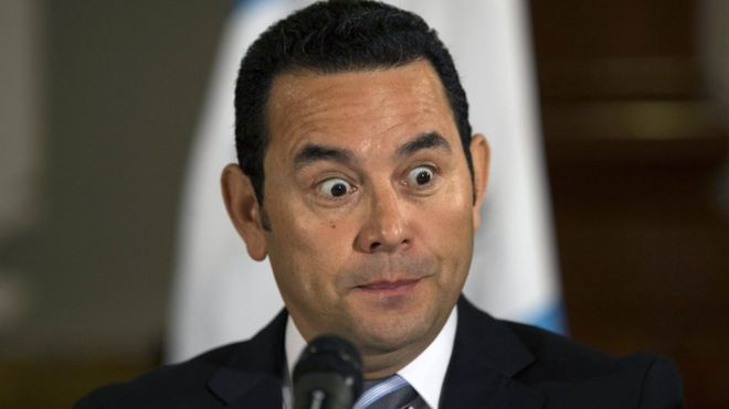 President-elect Jimmy Morales makes a face during a press conference in Guatemala City