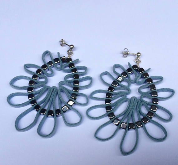 Silver hoops with hematite  cubes and  man.made light