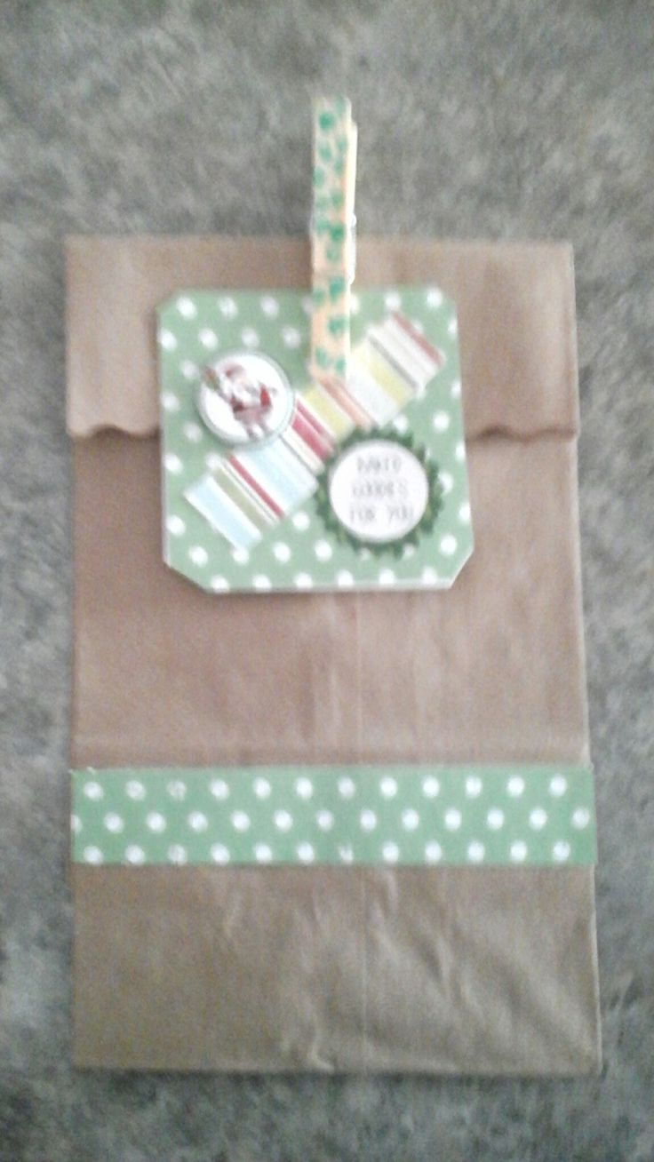 brown paper bag, decorated and fill with treats.