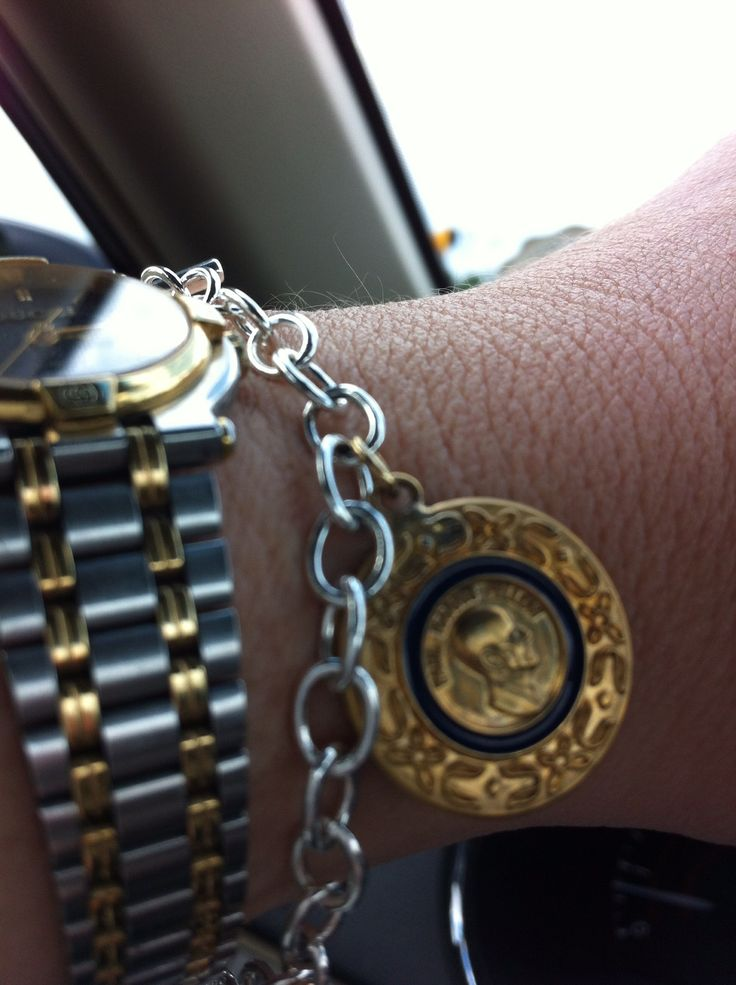 Convert pins into charms and add to bracelet. This is my Paul Harris pin from Rotary International.