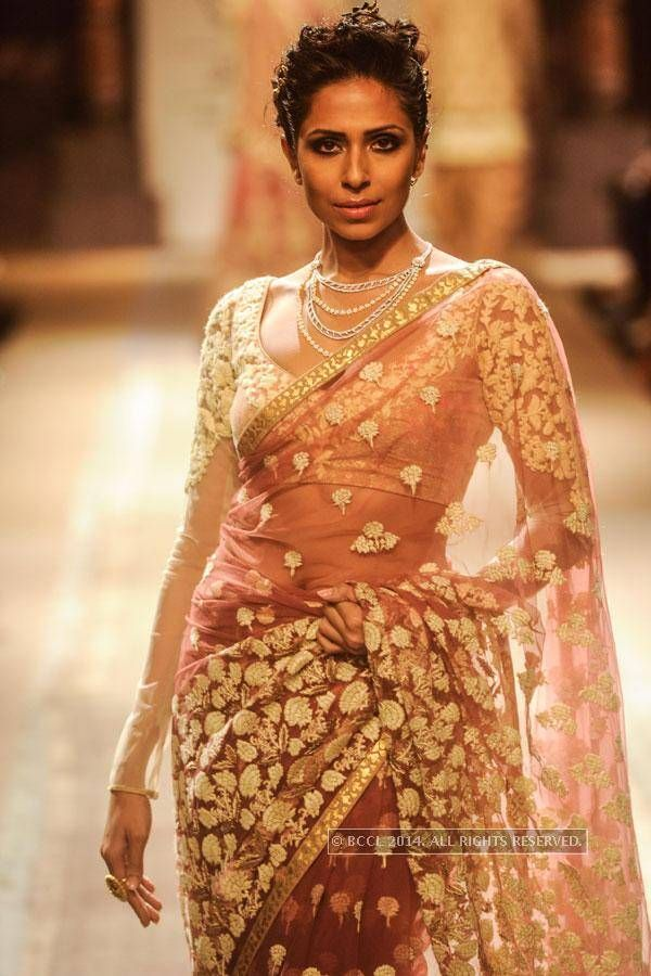 Love the blouse - elegant long sleeves. LFW '14: Anju Modi