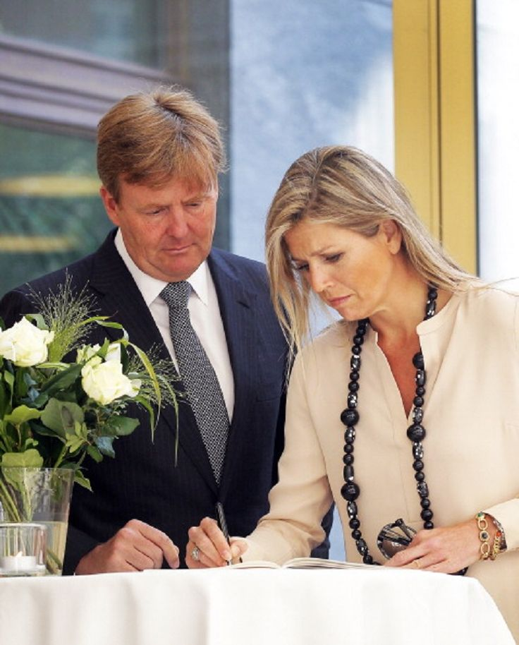 Queen Maxima and King Willem-Alexander of The Netherlands sign the book of condolence at the Ministry of Security and Justice for the victims of Malaysia Airlines flight MH17, 18.07.2014 in the Hague, Netherlands.