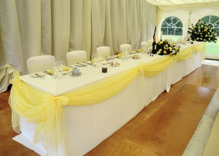 Lemon organza swag on top table. This really set off the top table in a marquee wedding Www.dedicated2detail.co.uk