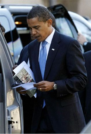 President Barrack Obama with a copy of Derek Walcott's collected poems