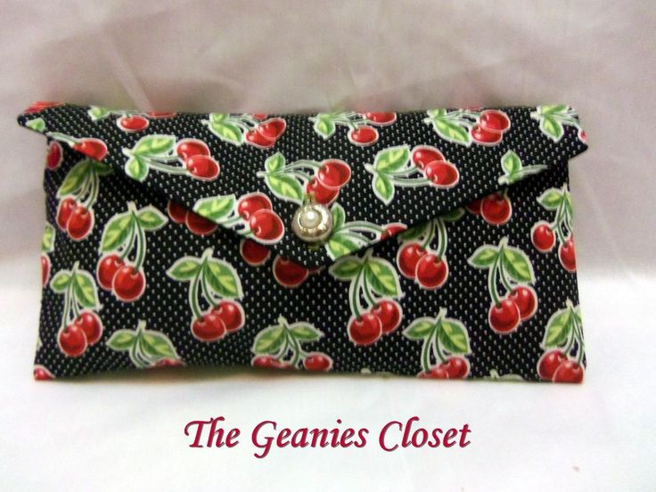 "Made especially for you by ""The Geanies Closet. Walk into the room ""Purse First""! with this adorable Cherry, polka-dot Clutch Bag. It is made of Cotton/Polyester blend textiles and the inside is solid black. 