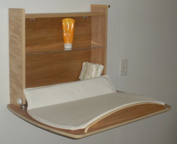 Wall mounted baby changing table that converts to desk. via Kinder and Wellness on Etsy