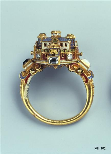 Very fine renaissance ring in gold and elaborate enamel work with diamond accents, reproducing a castle.