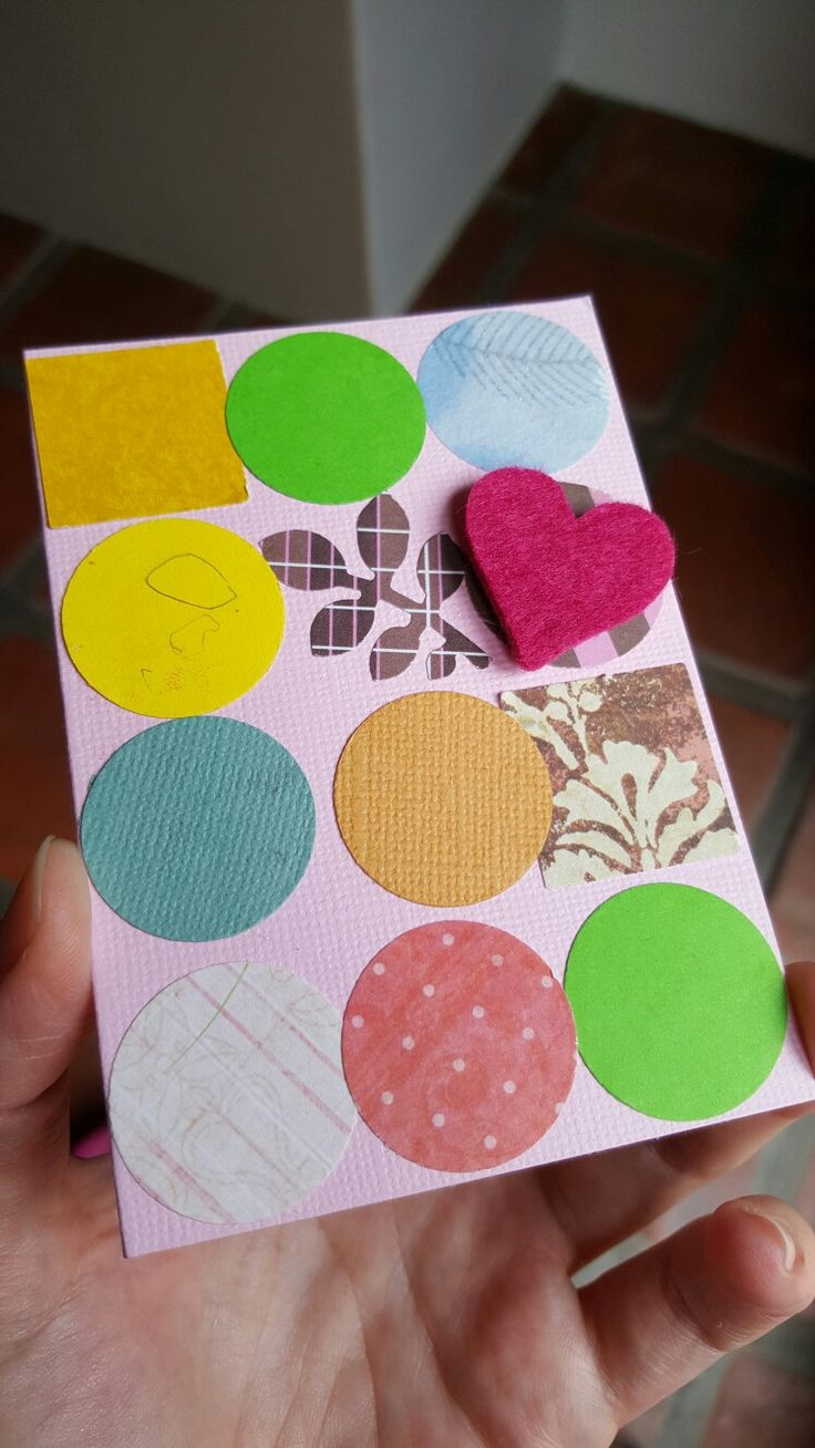 Card decorated by my 3 year old by punching circles (and 2 other shapes) from random pieces of pattern paper. This is such an easy project for a toddler.
