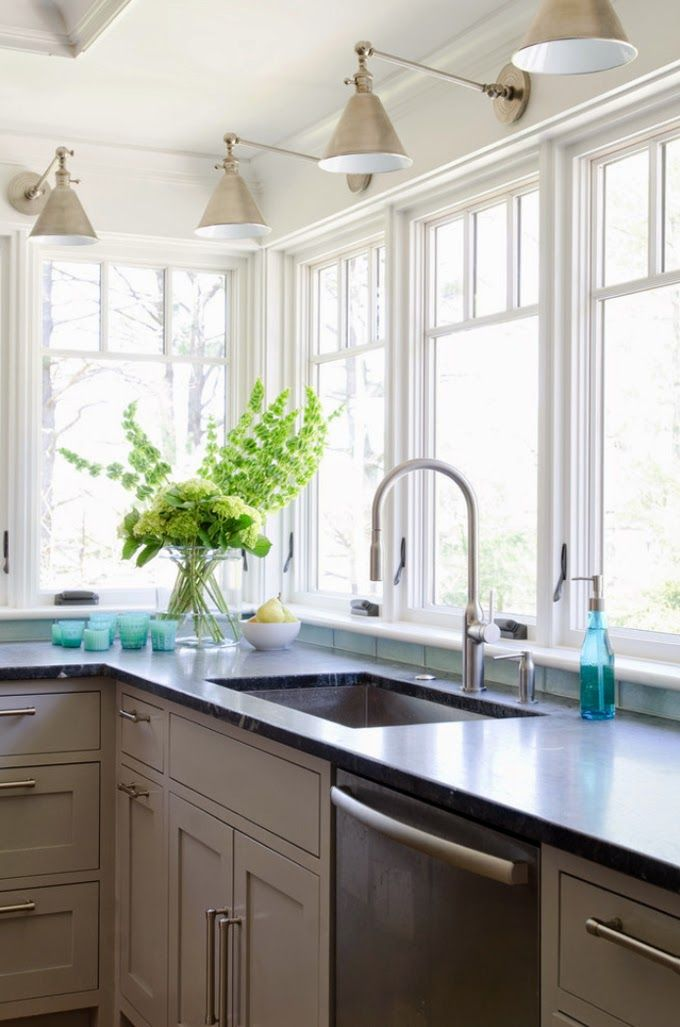 Kitchen windows, love the simplicity and pop of green in the flowers
