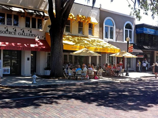 Park Avenue in Winter Park, Florida is a quaint downtown area full of specialty shops and cafes.  A beautiful public park is across the street.