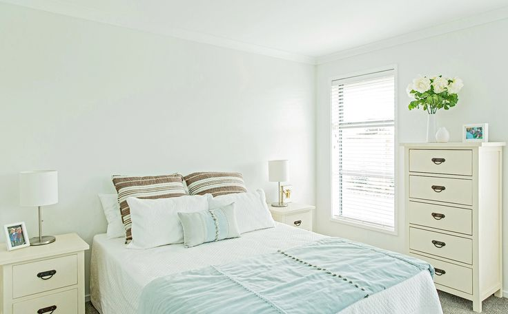 A lovely light main bedroom.