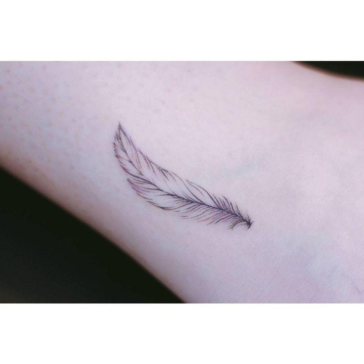 Feather tattoo #linetattoo #tattooseoeon #minimaltattoo
