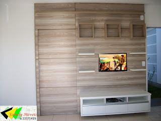 FAMILY MÓVEIS: Sala integrada a cozinha. Uma porta de correr embutida no painel da TV da privacidade ao quarto e banheiro.