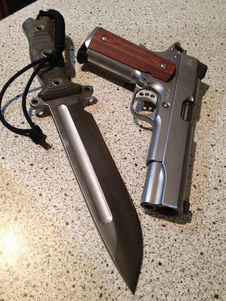 Wilson Combat 1911 with Custom bowie knifeFind our speedloader now!  http://www.amazon.com/shops/raeind