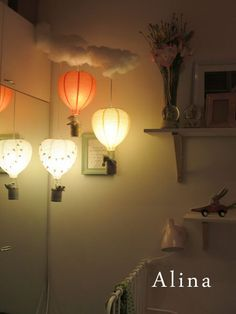 I love this idea of hot air balloon lights to add a little whimsy to a baby's room.