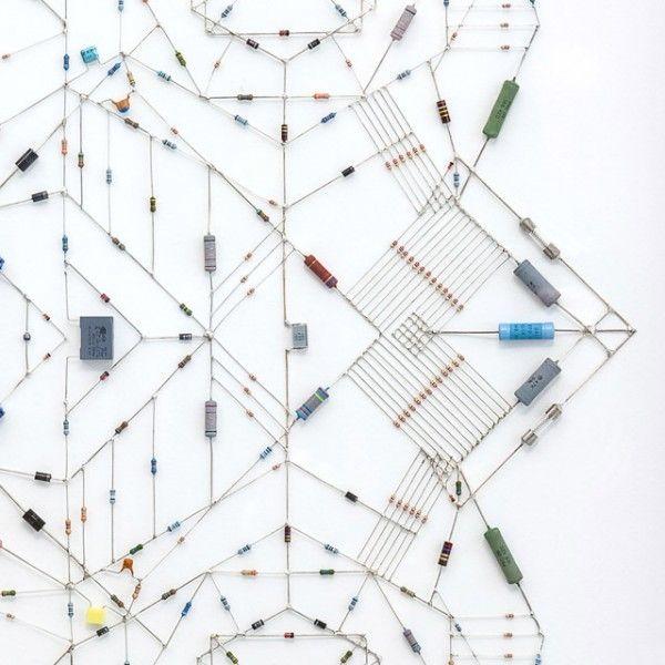Italian-born, London-based artist Leonardo Ulian's latest work creates these beautiful symmetrical mandalas with refurbished computer chips and electronic components