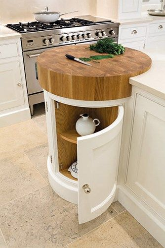 I like the idea of this chopping block - maybe use this idea for one corner of a run of cabinets | Painted Bespoke Kitchens - Tom Howley