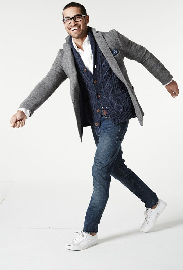 A cardigan over a T-shirt or a button down with another layer over it, like a leather jacket or a sport coat.