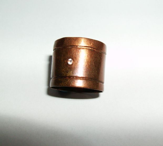 Copper ring with white zircon