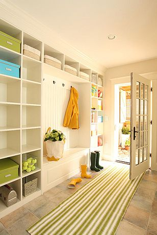 """SHELVING galore entryway! If you need the extra storage, this idea is perfect for you! If you are more simplistic in style, go with fewer shelves so it doesn't look too sparse and keeps a """"warm inviting"""" feel."""