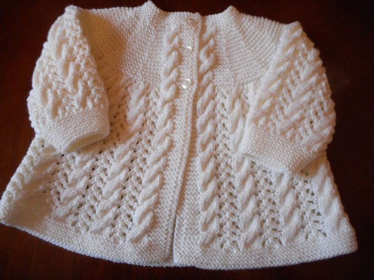 Baby matinee jacket, front. Finished object by LuxuryHandKnits. I wonder if I can do this top-down with 8 increase lines for the round yoke in garter stitch. Cables, and maybe arrow lace between the cables? See [https://www.pinterest.com/pin/460563499372066843/]