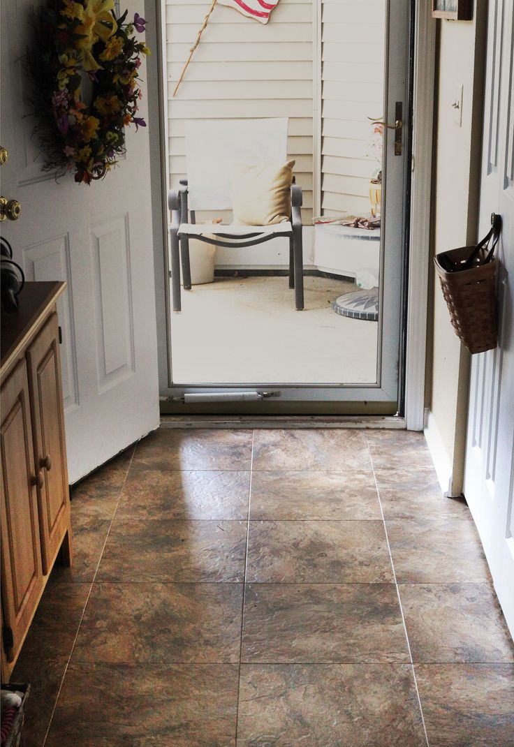 An Ann Arbor condominium entryway remodel, featuring Dura Ceramic flooring from their Sierra Slate collection.