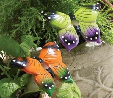 Not only do these colourful terracotta butterflies decorate your plant pots but they also water your plants too!