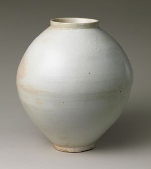 Jar, Joseon dynasty (1392–1910), second half of 18th centuryKoreaWhite porcelain   H. 14 3/4 in. (37.5 cm)(1979.413.1)  metropolitan museum of art     Plain globular jars like this piece are affectionately termed dalhangari,  or moon jars. Most examples, however, are not as perfectly round as a  full moon. Many were formed by joining two halves (the top and bottom  semi-spheres), often resulting in a visible joint mark near the middle  and slight irregularities in the overall form.