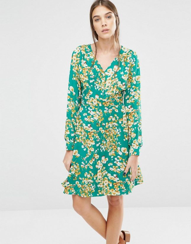 This green floral dress is perfect for a vintage vibe as an outdoor summer wedding.