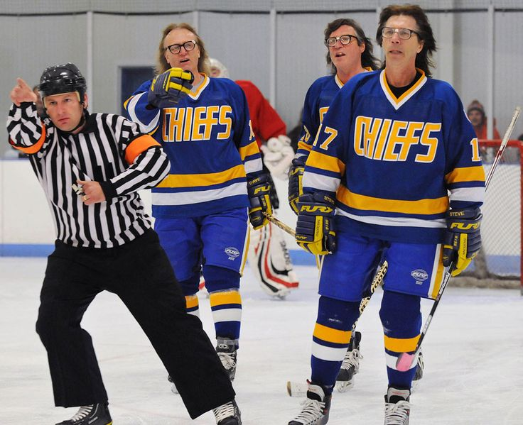 """A referee signals a penalty against the Hanson Brothers, from the movie Slap Shot, after ""beating up"" an opponent during a hockey game that benefited the Pennsylvania Breast Cancer Coalition, Saturday in Palmyra, PA"""