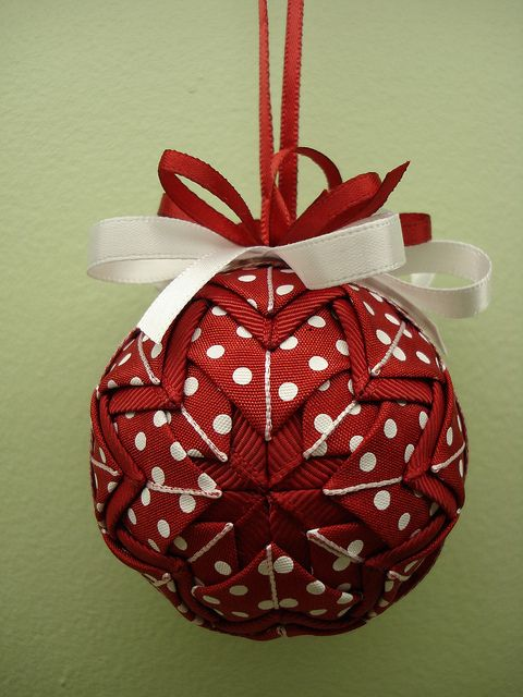 "Site has video for Kimemon (?) ornament as well - I prefer it - although this folded fabric ornament might be nice with some stitching and less ""country"" fabrics.  Quilted Christmas Ornament video tutorial.  Very easy and really pretty.  correct spelling is kimekomi"