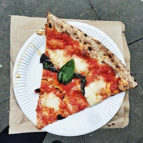 A slice from HomeSlice | 21 Of The Most Delicious Cheap Eats In London best pizza of my life-homeslice- covent gardens
