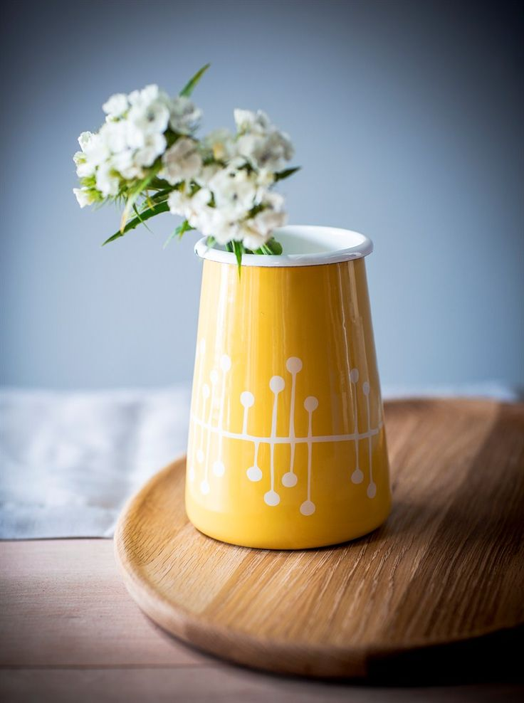 Inspired by a mid century design this holder looks equally stunning filled with wooden spoons or flowers.