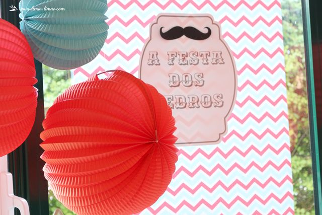 paper lanterns int the colors of this moustache/man themed party