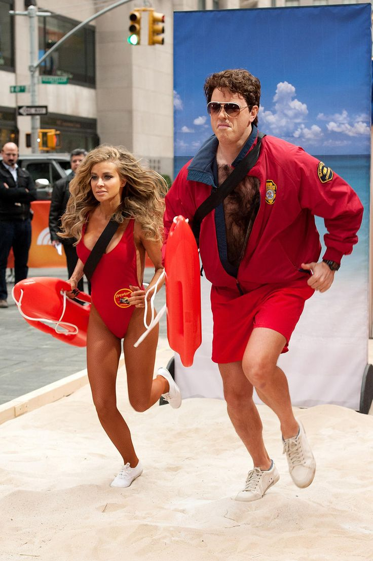 "Carmen Electra and Willie Geist -- A very hairy-chested Willie Geist, who dressed up as David Hasselhoff, got a little help from Carmen Electra! The former ""Baywatch"" hottie took off at a sprint through Rockefeller Center in search of someone to save. These two are clearly on a mission. (10/31/13) Credit:  D Dipasupil/FilmMagic"