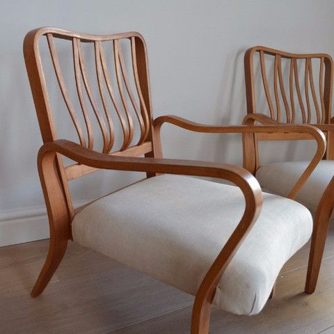 """A stunning and rare pair of beech bent ply """"Linden"""" arm chairs designed in 1948 by G.A Jenkins for Packet Furniture of Great Yarmouth as part of their Tecta range. This model is usually attributed to Eric Lyons who also designed for Packet. This model is featured in the V&A Museum, London. """"This chair dates from the end of the utility period and and demonstrates awareness of the flowing lines of much contemporary continental furniture, particularly Scandinavian and Italian."""" V&A Museum."""