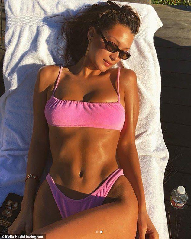 Bella Hadid stuns in tiny pink bikini asking for more sunshine   Bella  Hadid   Pinterest   Bella hadid, Bikinis and Bikini girls 1b9838df47d