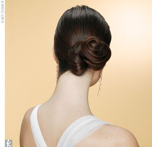 toppled knot     This side bun definitely looks a bit more basic from the front, but the back has a quirky, modern vibe thanks to the off-center twist.    Create the look:    Step 1 Part your hair off-center and, on the opposite side, pull strands into a low side ponytail.  Step 2 Use a 1/2-inch barrel curling iron to add texture to straight hair a ...