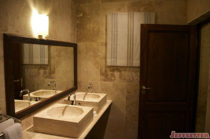 The Honeymoon Suite Bathroom I was curious to see if the bathroom matched the photos on the Vuyani website/Jetsetter and I'm pleased to say that it looks exactly as you would expect. Nice stone, double sinks, a shower (not pictures), bathtub and throne room.