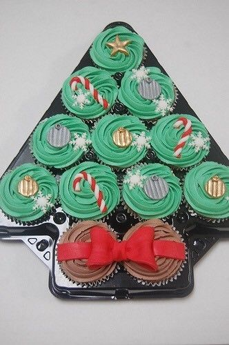 The Christmas Tree Platter Cupcake Holder. Holds 12 cupcakes. Sturdy plastic platter, each cupcake cavity has 2 inch base and the total depth including the lid is 2.5 inches. The lid fits and secures really well with a pop in system, it is clear so that you can display your cakes and is decorated with a Christmas tree pattern.    Perfect to use when giving cakes as a Christmas gift or for selling your Christmasfayre!
