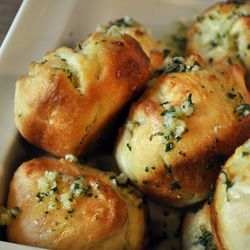 Garlic Rolls made with premade pizza dough, olive oil, garlic and dried parsley.