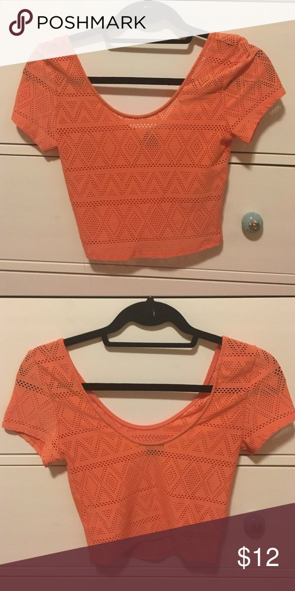 Peach Aztec Crop Top Peach in color. Aztec design with hole cut outs. Scoop neck / scoop back. Worn only about 5 times. Sparkle & Fade Tops Crop Tops