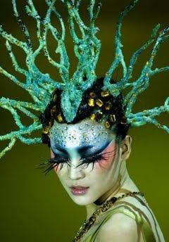 This headpiece is very intricate and bold. It creates very nice asymmetrical balance in the photo