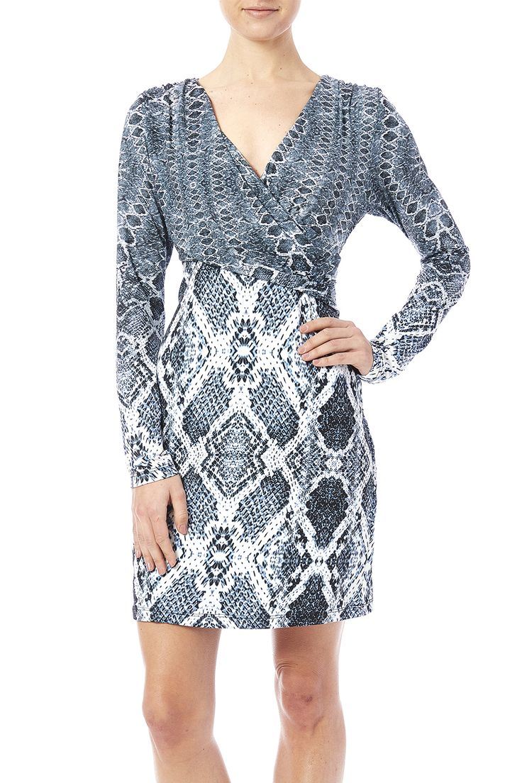 Step out in this sexy long sleeve snakeskin dress! Super flattering and tight to the body easy to transition from work to play.  Faux Wrap Dress by Tart Clothing. Clothing - Dresses - Wrap Dress Clothing - Dresses - Printed Clothing - Dresses - Long Sleeve North Carolina