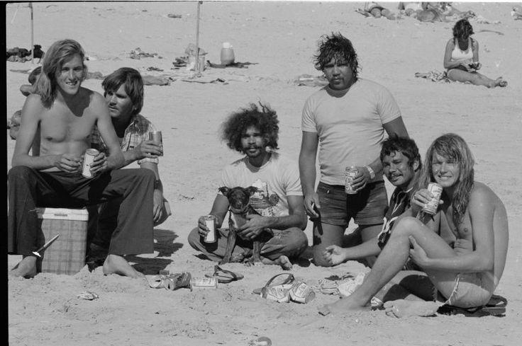 297309PD: Philip Brenton (sitting on esky) and his brother John (far right) at the Shinju Matsuri Beach Carnival, 1977 https://encore.slwa.wa.gov.au/iii/encore/record/C__Rb2852172