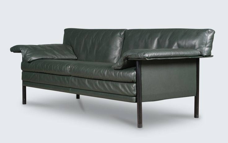 Beautiful Danish 3-seater model 'Evita' sofa by Durlet, Belgium with rectangular draping armrests. This lovely piece sits atop a sturdy lacquered metal frame and is covered in a stunning, dark green leather. Two available, each sold separately.