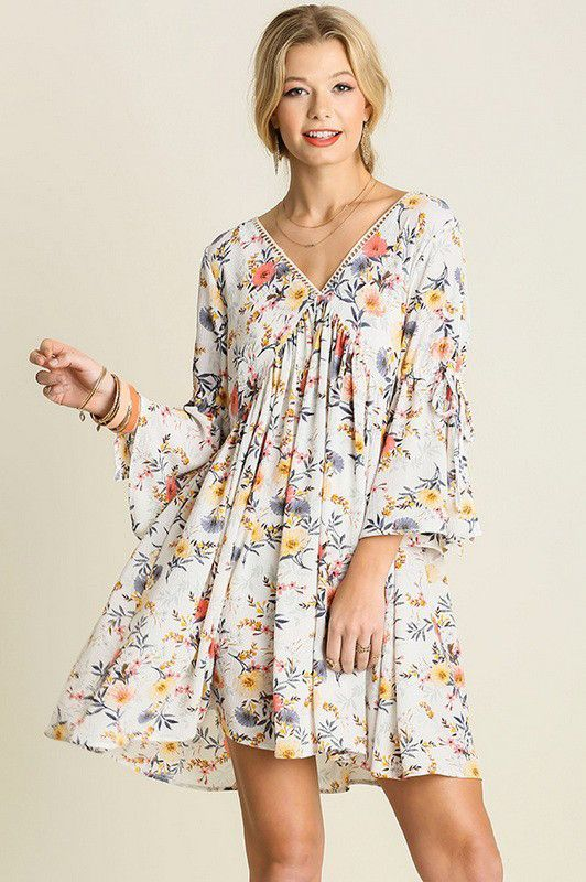 Easter dress is written all over this White Floral Sleeve Slit Peasant Dress! Pair this wildflower print dress with some pumps and head to church or pair with pumps for a cute spring date look!  White Floral Sleeve Slit Peasant Dress - Single Thread Boutique, $39.90 #white #floral #sleeve #slit #peasant #dress #gorgeous #v #neck #three #quarter #sleeve #flare #cut #out #lace #womens #fashion #singlethreadbtq #shopstb #boutique